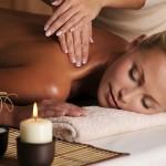 Professional masseur doing massaging  of female neck